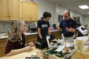 Students and mentors collaborate to meet the build season deadline.